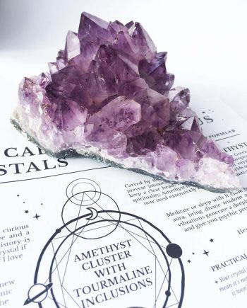 Amethyst cluster from Uruguay is peppered with Black Tourmaline inclusions, perfect for the crystal connoisseur.